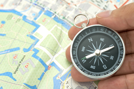 Businessman holding a compass with Japan map using as background  travel concept with copy spaces and white space for your. Stok Fotoğraf