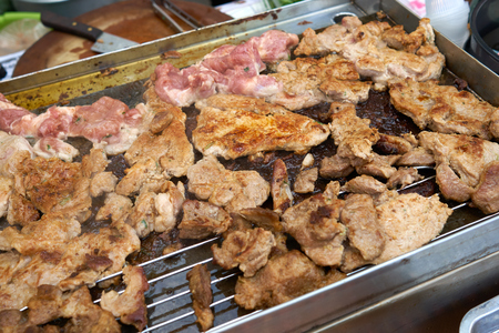 Grilled pork roasted on steel plate or grill In the street food market of Thailand is a culture of easy-to-buy. Tidy The food is popular with foreigners and Thai.