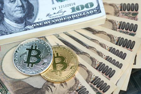 The digital currency (Bit coin) is made of silver and gold. Place Japanese bank notes and American banknotes (dollars). using as background business and finance concept concept with copy space. Kho ảnh