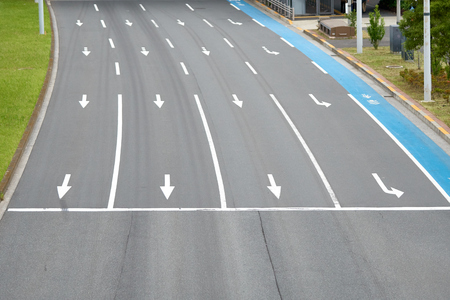 Road surface in Japan It is a direct way to have a bike. Painted in blue A car park Prior to splitting traffic lights, traffic conception, road markings on the road.