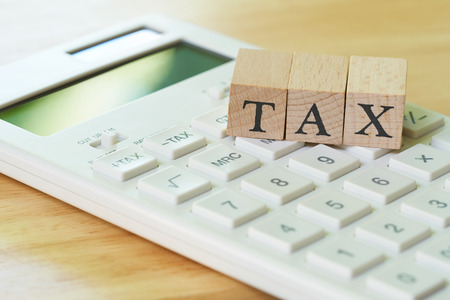 Pay Annual income (TAX) for the year on calculator. using as background business concept and finance concept with copy space  for your text or  design.