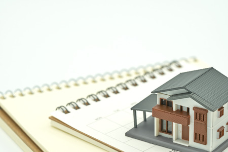 A model house model is placed on a Calendar. as background property real estate concept with copy space for your text or  design. Kho ảnh