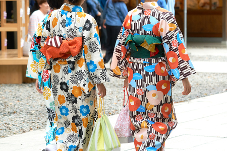 Young girl wearing Japanese kimono standing in front of Sensoji Temple in Tokyo, Japan. Kimono is a Japanese traditional garment. The word Stock Photo