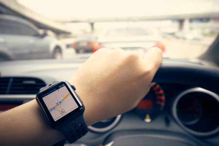Smart Watch Navigation on the Road In the state of traffic jam in the city. Easy to travel. Tours and travel concept traffic.