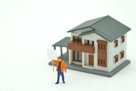 Miniature businessmen standing Investment Analysis Housing Or investment in movable property. using as background business concept and real estate concept with copy space for your text or design.