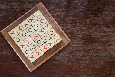 OX (tic tac toe) wood board game using as background business direction, planning concept. vintage tone. Stock Photo