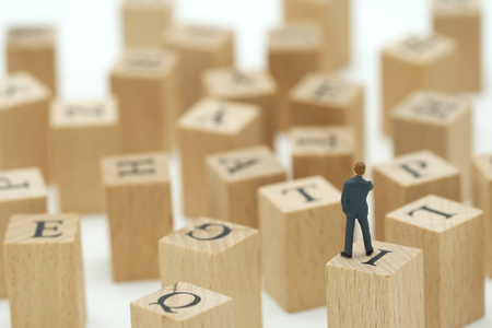 Miniature people businessmen analyze standing on wood words with performance as background strategy concept and Business concept with copy space.