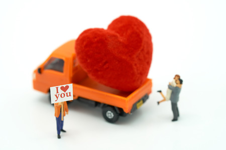 Couple Miniature people standing with Red heart is the promise of love. using as background Valentine concept with copy spaces for you