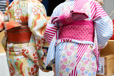 Young girl wearing Japanese kimono standing in front of Sensoji Temple in Tokyo, Japan. Kimono is a Japanese traditional garment. The word Kho ảnh