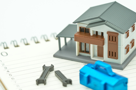 House Models and Equipment Models placed on a Book Rankings (list). Home Repair and Construction . using as background property real estate concept with copy space for your text or design. Kho ảnh