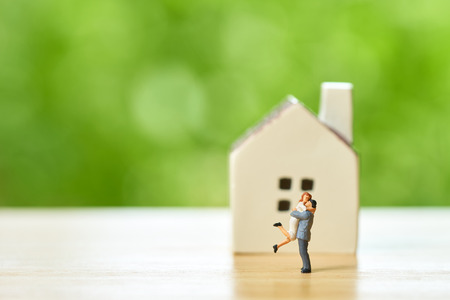 Couple Miniature 2 people standing model with house model make family Feel happy.as background real estate and family concept with copy space. Kho ảnh
