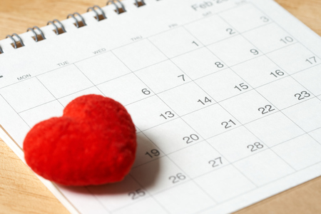 Heart shaped standing on Calendar. Day 14 meets Valentine Day. Red heart is the promise of love. using as background Valentine concept with copy spaces for you
