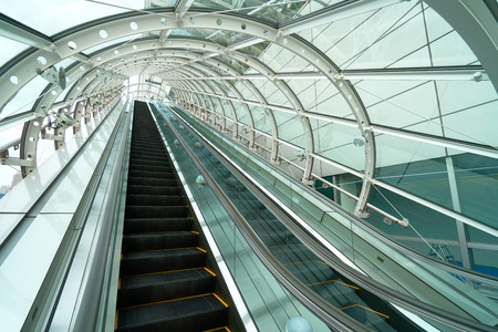 Escalator up and down Sneak through the glass roof. To prevent rain for public service users. Modern architectural ideas for technology Kho ảnh