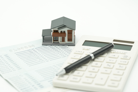 Home calculators, calculators, and pens put on bank notes. Investing in investment in real estate Home loan using as background business concept and real estate concept with copy space for your text
