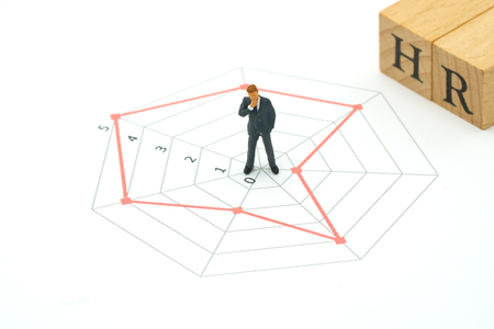 Miniature people businessmen standing on a Circle graphs of various skill levels. The concept used in selecting personnel to participate in the organization. with copy space. Kho ảnh
