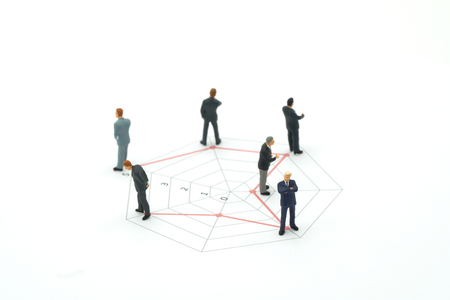 Miniature people businessmen standing on a Circle graphs of various skill levels. The concept used in selecting personnel to participate in the organization. with copy space. Stock Photo