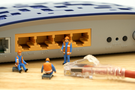 Miniature people Construction worker LAN connection Or connect to the internet. Communication ideas, maintenance. Stock Photo