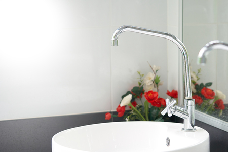 Modern white sinks provide a clean feel. Germs and dirt the bathroom, the concept of health and cleanliness.