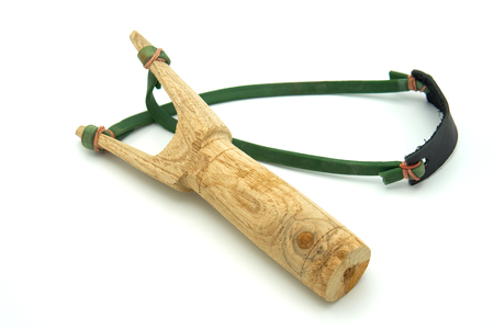 The catapult Y-sling made of wood intended for firing stones or shells instead of smaller. Jean indigenous people of Thailand Shoot on white