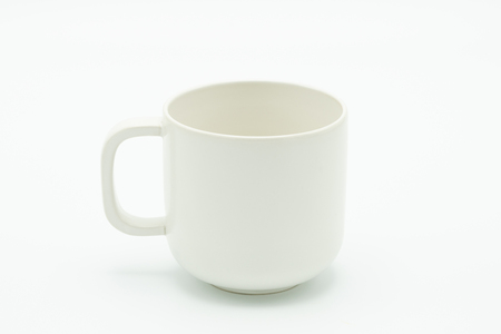 White coffee mug located in the middle of the picture. Has a white background As a raw material of the media. with copy space. Stock Photo