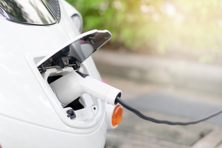 Bring Battery Chargers Connect with electric car To put the electric car into the car. Clean energy does not pollute the air. Energy conservation concept Alternative energy