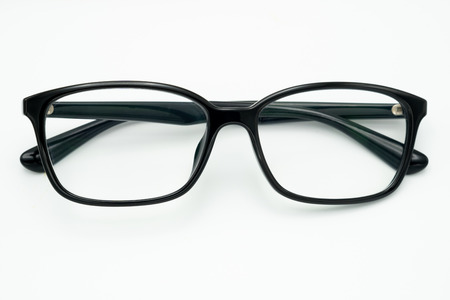 Black eye glasses spectacles with shiny black frame For reading daily life To a person with visual impairment. White background as background health  concept with copy space. Stock Photo