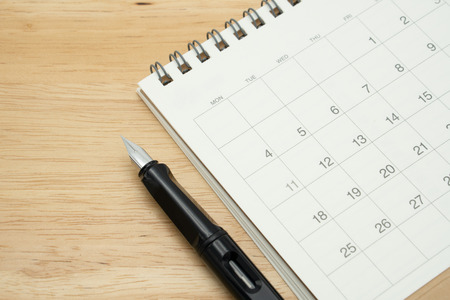 the year on Calendar and Fountain pen. using as background business concept and finance concept with copy space  for your text or  design. Stock Photo