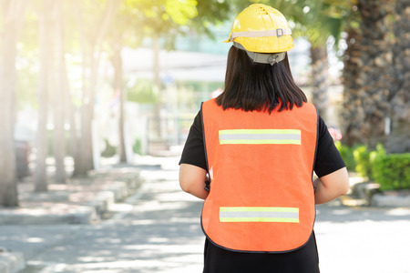 Foreman oversee construction work, wear reflective workwear for work safety. The reflector has a silver reflective reflector and a green reflective kit for a clear view. Stock Photo