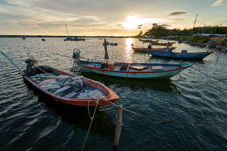 View of the fishing harbor Sunset Latinos There is a boat landing. In a fishing village in Rayong, Thailand, fishing is the main occupation of the people.