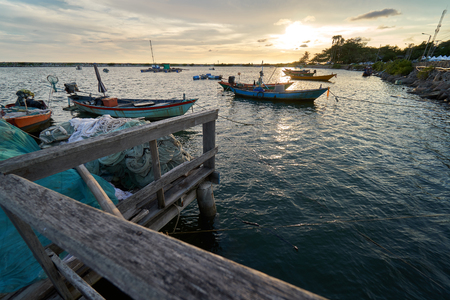 Landscape of view the fishing harbor Sunset Latinos There is a boat landing. In a fishing village in Rayong, Thailand, fishing is the main occupation of the people. Stock Photo