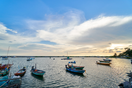 Landscape of view the fishing harbor Sunset Latinos There is a boat landing. In a fishing village in Rayong, Thailand, fishing is the main occupation of the people. Kho ảnh