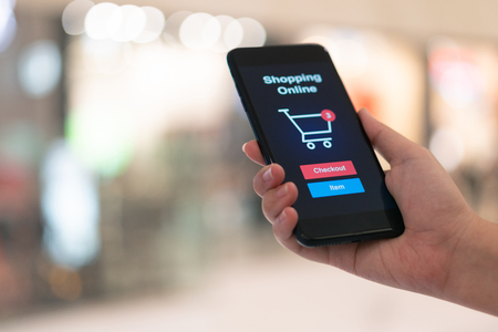 Online shopping with smartphone and shopping bags delivery service using as background shopping concept and delivery service concept with copy space  for your text or  design. Stockfoto
