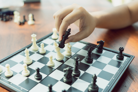 Businessman holding a King Chess is placed on a chessboard.using as background business concept and Strategy concept with copy space for your text or design. Standard-Bild - 114602920