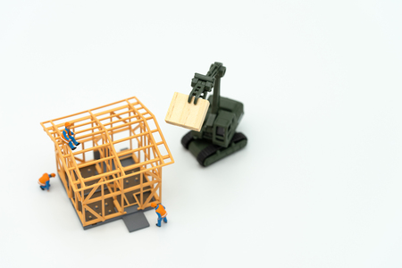 Miniature people Construction worker repair A model house model  using as background real estate concept and repair concept with copy space for your text or design. Standard-Bild - 114603152