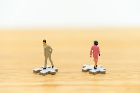 Miniature people businessmen standing on white Jigsaw. The concept used in selecting personnel to participate in the organization. with copy space. Banco de Imagens - 116412870
