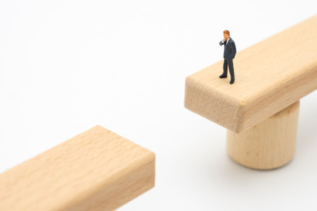 Miniature people businessmen Standing on a wooden bridge Looking at the opposite side, analyzing the way to reach the destination. Concept of working to reach the goal And work allowance