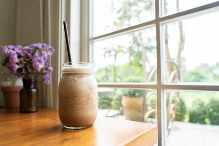 Blended cocoa drink in a tall clear glass Was placed by the window Gives a refreshing feeling Good for body health and skin health