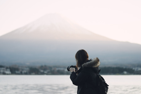 Young Asian tourists, aged 25-35, photographed with camera. Was photographed Mount Fuji. It is not a tourist destination in Japan. Stock Photo