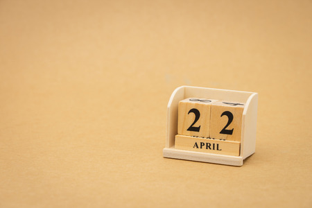 April 22 : wooden calendar on vintage wood abstract background. Earth Day using as background Universal day concept and Earth Day concept with copy space  for your text or design.