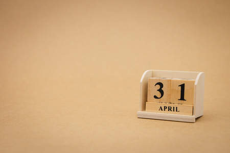 April 31 wooden calendar on vintage wood abstract background. using as background Universal day concept with copy space for your text or design.