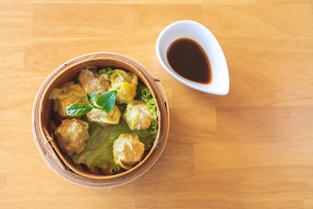 Pork dumplings packed in bamboo trays with Chinese national dishes. Popular for breakfast Banco de Imagens