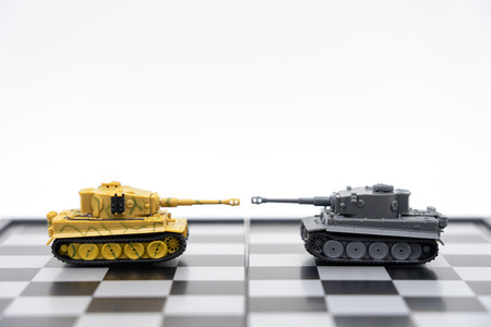 Tank model on the back Negotiating in business. as background revolution concept and strategy concept with copy space.