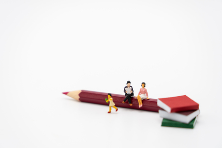 little kids Miniature people standing on books using as background Education concept and Learning concept with copy space and white space.