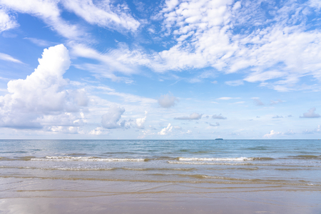Yellow warm sand and summer sea with blue sky and copy space. Sea view during daytime with blue sky and white clouds. Summer season concept. 写真素材 - 124722585