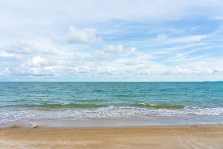 Yellow warm sand and summer sea with blue sky and copy space. Sea view during daytime with blue sky and white clouds. Summer season concept. 写真素材 - 124722419