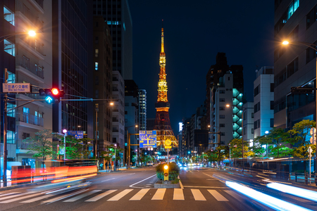 Cars and Pedestrian walking on Street Scene of Traffic at Tokyo tower crossing in Tokyo