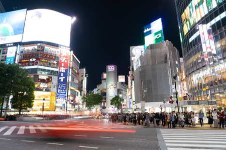Cars and Pedestrian walking on Street Scene of Traffic at Shibuya Crossing in Tokyo Editöryel