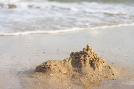Sand castles destroyed by sea water But the remains of the ruined soil Summer concept Unsustainable and uncertain Reklamní fotografie