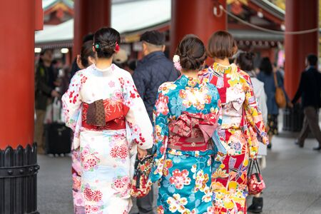 Young girl wearing Japanese kimono standing in front of Sensoji Temple in Tokyo, Japan. Kimono is a Japanese traditional garment. The word 写真素材