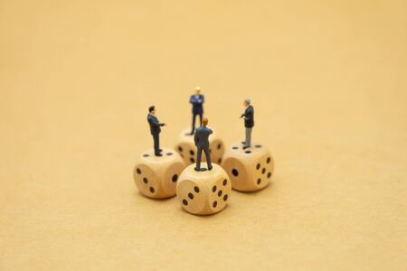 Miniature people businessmen standing on Panicked look stock market Investment Analysis investment using as background business concept and teamwork concept with copy space